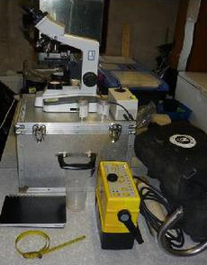 We require a clean table, with an electrical source for our microscope, and access to warm water.